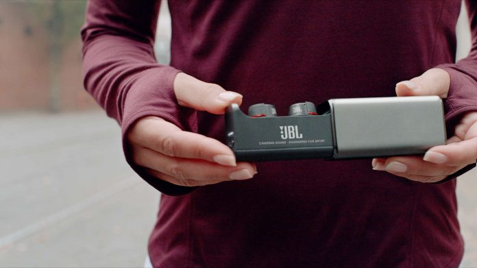 UA True-Wireless Flash by JBL_Lifestyle charging case female_1500x843